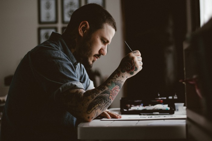 Tattoo artist at desk